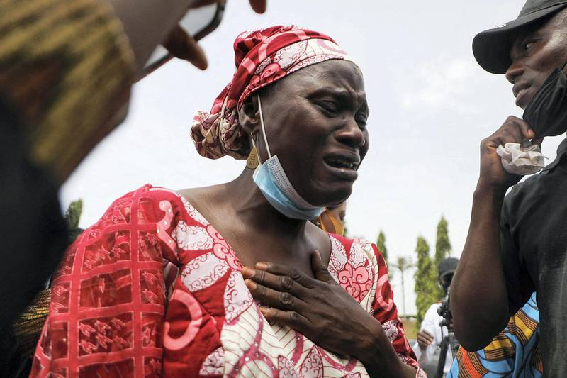 Rabi Magaji-Zakariah (C), a mother of one of the Federal College of Forestry Mechanization students who has been abducted, cries during a demonstration in Abuja on May 4, 2021 to demand the release of their families who has spent 55 days in captivity. - Gunmen raided a college in northwestern Nigeria and kidnapped at least 30 students, government officials and parents said on March 12, 2021, in the latest mass abduction targeting a school. (Photo by Kola Sulaimon / AFP)