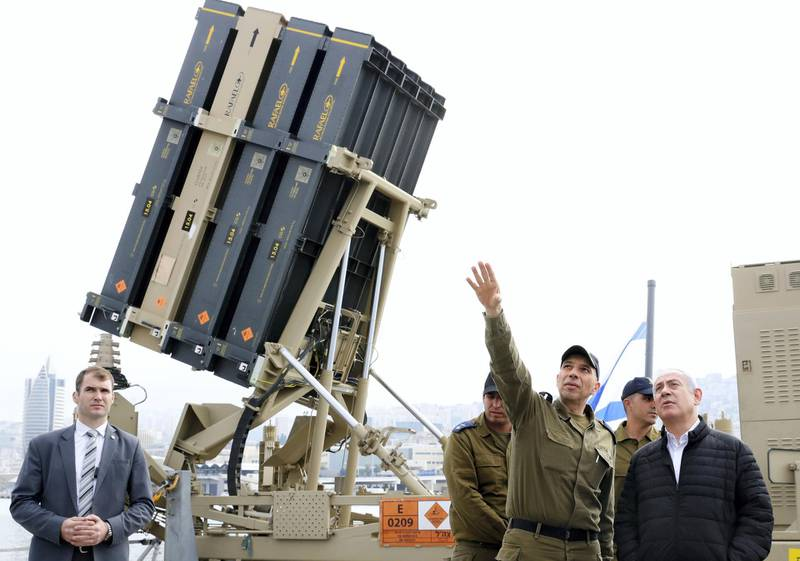 Israeli Prime Minister Benjamin Netanyahu, right, listens to a soldier as he stands near a naval Iron Dome defence system, installed on a Sa'ar 5 Lahav Class corvette of the Israeli Navy, in the northern port of Haifa, Israel, Feb. 12, 2019. The Iron Dome is designed to intercept and destroy incoming short-range rockets and artillery shells. (Jack Guez/POOL via AP)