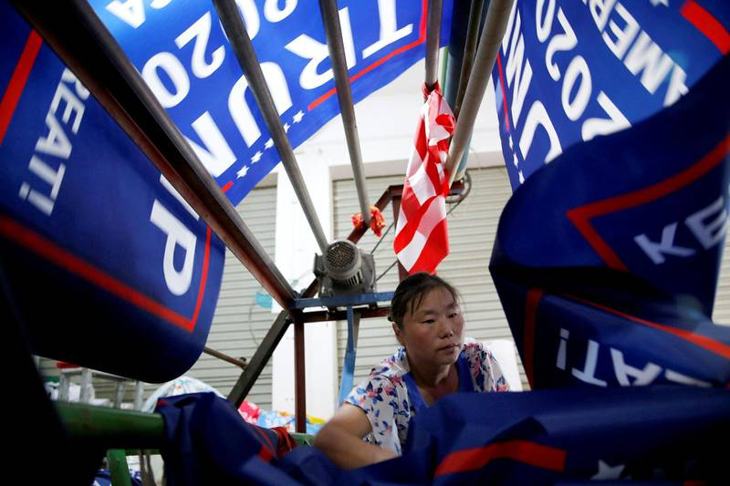 """A worker makes flags for U.S. President Donald Trump's """"Keep America Great!"""" 2020 re-election campaign at Jiahao flag factory in Fuyang, Anhui province, China July 24, 2018. Picture taken July 24, 2018. REUTERS/Aly Song"""