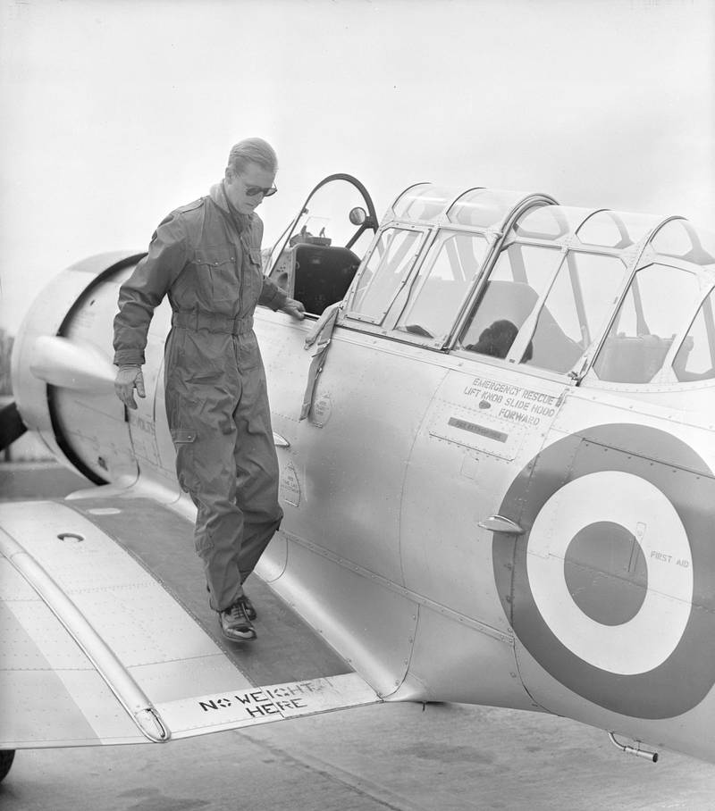 4th May 1953:  The Duke of Edinburgh disembarks from a Harvard Trainer aircraft after a flight, at RAF White Waltham, Berkshire, where he has been training for his 'wings'.  (Photo by PNA Rota/Getty Images)