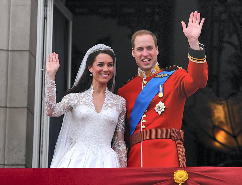 LONDON, ENGLAND - APRIL 29: Their Royal Highnesses Prince William, Duke of Cambridge and Catherine, Duchess of Cambridge wave on the balcony at Buckingham Palace during the Royal Wedding of Prince William to Catherine Middleton on April 29, 2011 in London, England. The marriage of the second in line to the British throne was led by the Archbishop of Canterbury and was attended by 1900 guests, including foreign Royal family members and heads of state. Thousands of well-wishers from around the world have also flocked to London to witness the spectacle and pageantry of the Royal Wedding. (Photo by John Stillwell-WPA Pool/Getty Images)