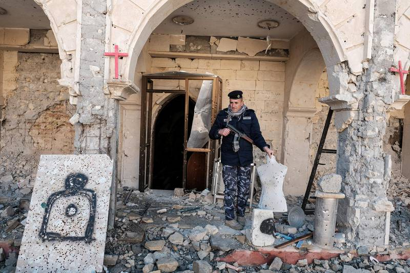 Qaraqosh, December 27 2016 Burned and devastated Church of St Mary al-Tahira. Makeshift shooting range of jihadists.The offensive to retake Iraqs second city from Islamic State of Iraq and the Levant (Isil) began in mid-October.Shortly afterwards, Iraqi forces and local militias succeeded in driving Isil out of the historic Christian town of Qaraqosh on Iraqs Nineveh plain, 10 miles east of Mosul, which was captured by the jihadist group in the summer of 2014.  Destruction is bad enough, though it is not total. Isis fighters set fire to many ordinary houses in addition to the churches in the days before they left, but  possibly because there was no furniture left to burn since it all had been looted  most of these houses look as if they could be made habitable after extensive repairs. (Photo by Maciej Moskwa/NurPhoto via Getty Images)