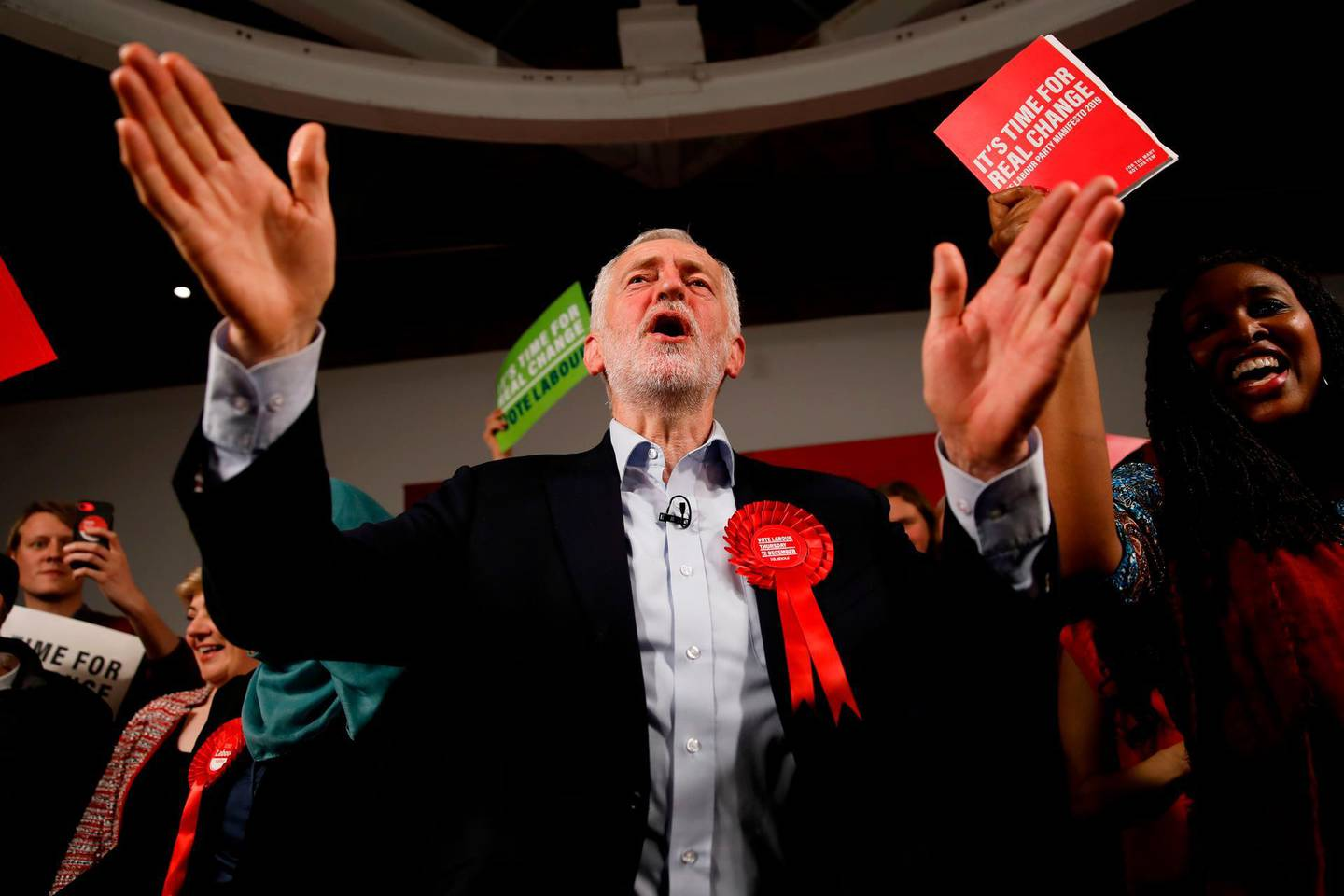 (FILES) In this file photo taken on December 11, 2019 Britain's Labour Party leader Jeremy Corbyn gestures with supporters and activists after delivering a speech during a general election campaign rally in East London. Britain's Labour party on Sunday goes online to try to reinvigorate grassroots support after years of bitter ideological in-fighting and stinging electoral failure.  / AFP / Tolga AKMEN