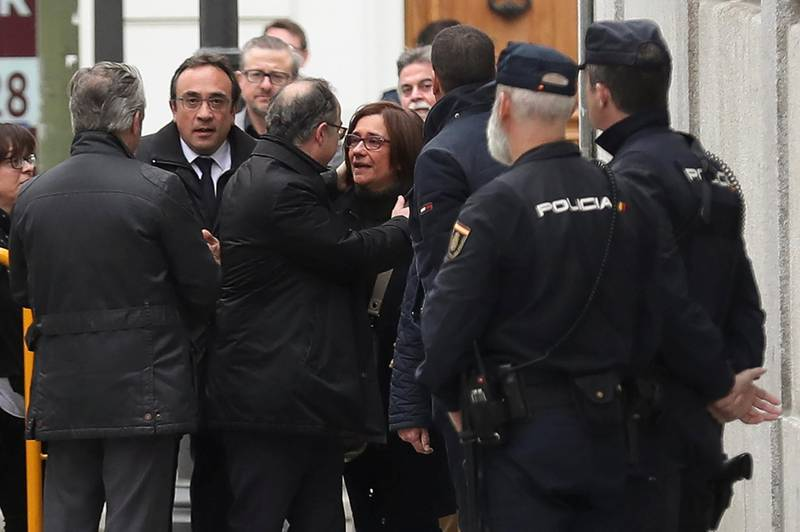Catalan politician Jordi Turull (C) embraces his wife Blanca Bragulat as he arrives to the Supreme Court after being summoned and facing investigation for his part in Catalonia's bid for independence in Madrid, Spain, March 23, 2018.  REUTERS/Susana Vera