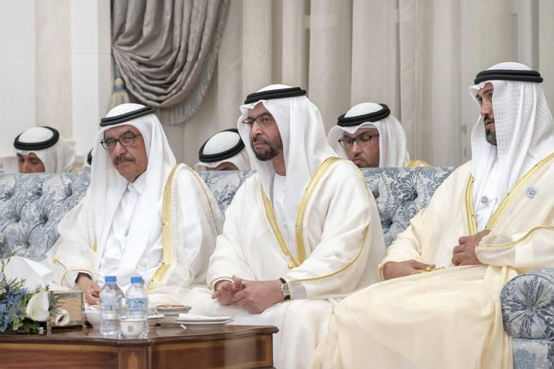 ABU DHABI, UNITED ARAB EMIRATES - August 21, 2018: (L-R) HH Sheikh Hamdan bin Rashid Al Maktoum, Deputy Ruler of Dubai and UAE Minister of Finance, HH Sheikh Hamdan bin Zayed Al Nahyan, Ruler's Representative in Al Dhafra Region, and HE Mohamed Mubarak Al Mazrouei, Undersecretary of the Crown Prince Court of Abu Dhabi, attend an Eid Al Adha reception at Mushrif Palace.   (Rashed Al Mansoori / Crown Prince Court - Abu Dhabi ) ---