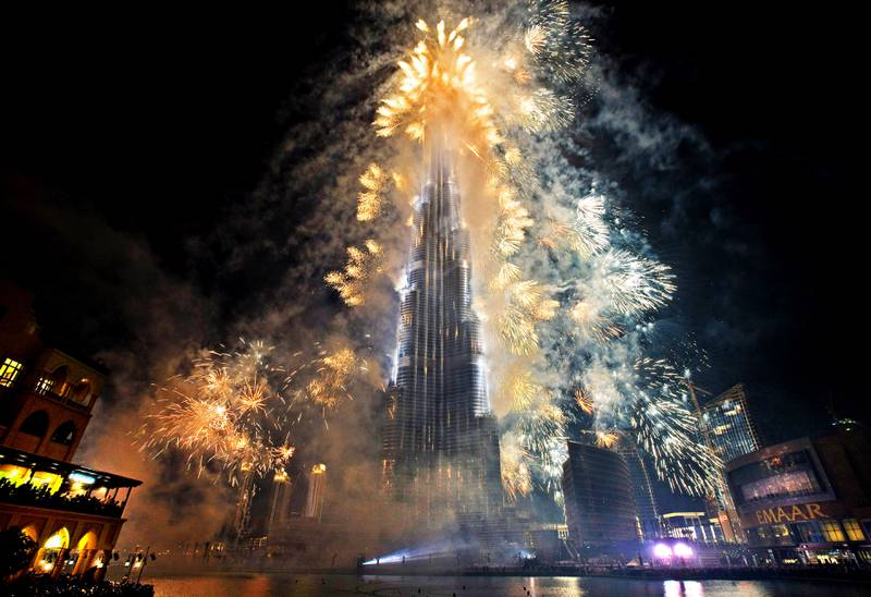 Dubai - January 4, 2010 - Fireworks light up the Burj Khalifa during the opening ceremonies in Dubai, January 4, 2010. (Photo by Jeff Topping/The National)  EDITORS NOTE: Building was opened at 8pm on January 4th, 2010 at which point the name changed from Burj Dubai to Burj Khalifa. Official name is now Burj Khalifa *** Local Caption ***  JT008-0104-BURJ KHALIFA_MG_9737.jpg
