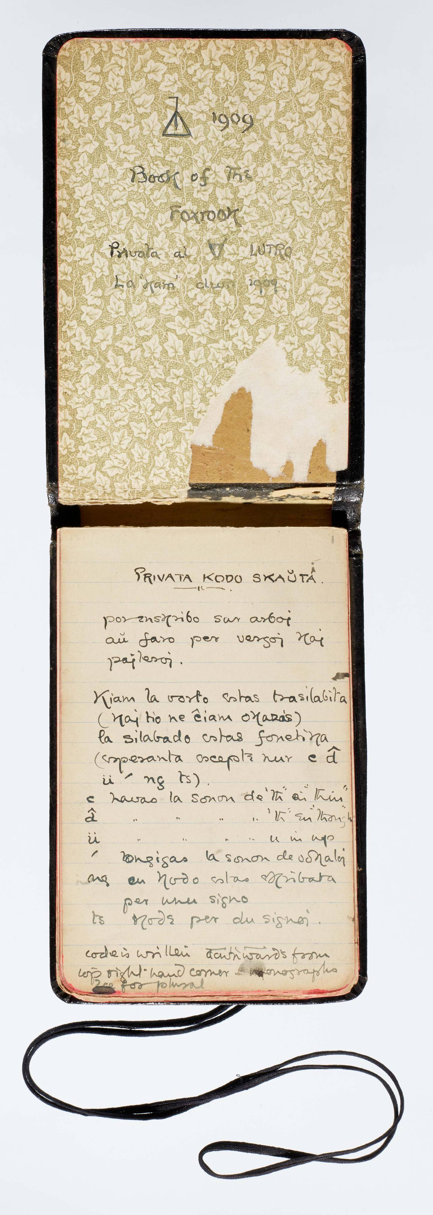 """Tolkien's Book of FoxrookAn unpublished Tolkien notebook, known as """"The Book of Foxrook,"""" revealing how, at the age of 17, he created his own 'Privata Kodo Skauta' or 'Private Scout Code'. This is the first known example of him inventing an alphabet, and foreshadows the fictional Elvish alphabet and languages he would create in The Lord of the Rings. The opening of the notebook is written in Esperanto and indicates his lifelong fascination with invented languages.Image credit: © The Tolkien Trust 1992, 2019Terms of use: Please note that this image is only permitted for use in news articles about the Bodleian Libraries' Babel exhibition and/or the accompanying publication. There must be no secondary use of this image. Reproduction of this image for any other purpose has not been cleared by the copyright owners."""