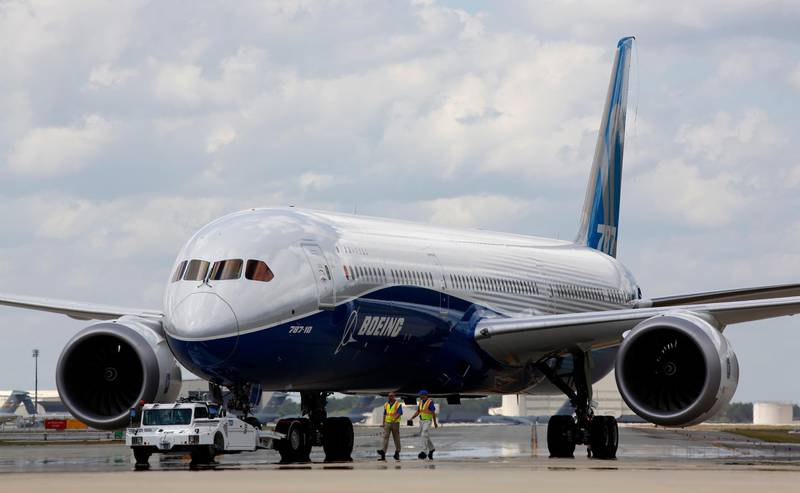 """FILE - In this March 31, 2017, file photo, Boeing employees walk the new Boeing 787-10 Dreamliner down towards the delivery ramp area at the company's facility in South Carolina after conducting its first test flight at Charleston International Airport in North Charleston, S.C. Singapore Airlines says it has grounded two of its Boeing 787-10 aircraft due to engine issues. The carrier in a statement on Tuesday, April 2, 2019, that """"premature blade deterioration was found on some engines"""" of its 787-10 fleet at recent routine inspections.(AP Photo/Mic Smith, File)"""