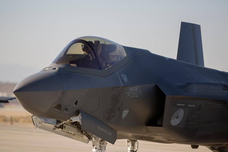 A Dutch Lockheed Martin F-35 Lightning II fighter jet takes off at Edwards Air Force Base, California, on November 24, 2015. The Lockheed Martin F-35 Lightning II is a family of single-seat, single-engine, all-weather stealth multirole fighters undergoing final development and testing for the United States and partner nations. The fifth generation combat aircraft is designed to perform ground attack and air defense missions.The program is the most expensive military weapons system in history, and it has been the object of much criticism from those inside and outside government—in the US and in allied countries.  / AFP PHOTO / DAVID MCNEW