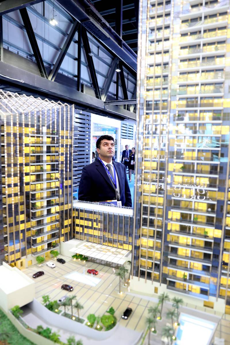Dubai, United Arab Emirates - September 11th, 2017: Visitors at the Sparkle Towers project at the16th addition of Cityscape Global. Monday, September 11th, 2017 at World Trade centre, Dubai.