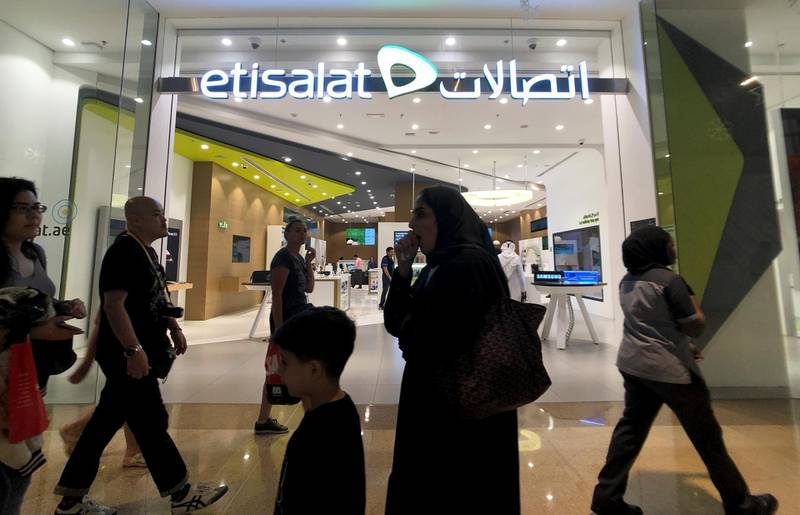 Shoppers walk in front of Etisalat Telecommunication in Dubai Mall, in Dubai, United Arab Emirates, December 20, 2018. Picture taken December 20, 2018. REUTERS/Hamad I Mohammed