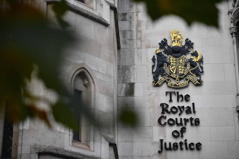 """Signage is seen on the side of the Royal Courts of Justice where the High Court is located in London on November 2, 2020.  Hollywood star Johnny Depp on November 2 lost a libel lawsuit against British newspaper The Sun for branding him a """"wife-beater"""" in a case at the British High Court that laid bare his chaotic lifestyle and shattered his global reputation. / AFP / Ben STANSALL"""