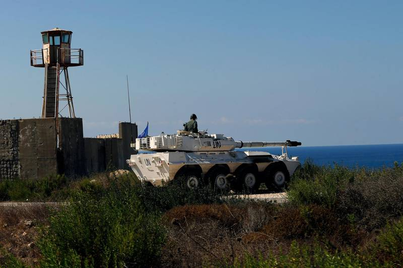 A UN peacekeeper sits atop a light tank near the post where the indirect talks between Israel and Lebanon were being held in the southern Lebanese border town of Naqoura, Lebanon, Wednesday, Oct. 14, 2020. Lebanon and Israel are to begin indirect talks Wednesday over their disputed maritime border, with American officials mediating the talks that both sides insist are purely technical and not a sign of any normalization of ties. (AP Photo/Bilal Hussein)