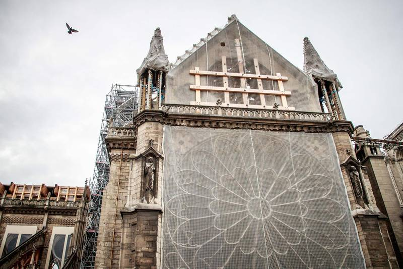 epa07922042 A view of the north side of the Notre-Dame Cathedral during consolidation works, six months after a fire ravaged the roof of the most visited monument in the French capital, in Paris, France, 15 October 2019. Six months after the historic monument was badly damaged by a huge fire last 15 April, consolidation works are continuing before the start of the restoration.  EPA/CHRISTOPHE PETIT TESSON