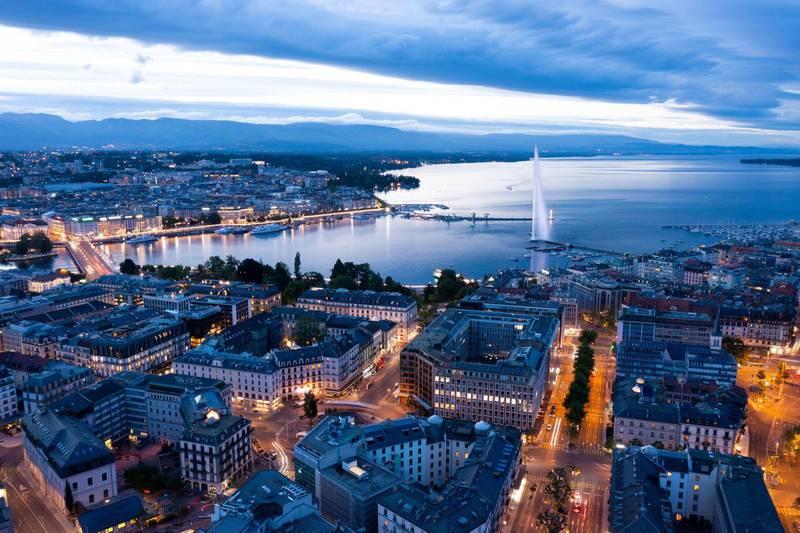 2G04CY8 Aerial  night view of Geneva city waterfront skyline in Switzerland. Alamy