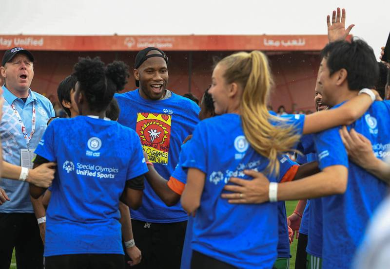 Abu Dhabi, United Arab Emirates - Didier Yves Drogba Tebily, an Ivorian retired profession footballer cheers with his team at the Unified Sports Experience at Zayed Sports City. Khushnum Bhandari for The National