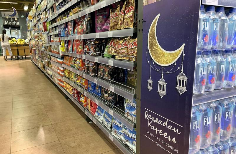 DUBAI, UNITED ARAB EMIRATES , April 20– 2020 :- Ramadan decoration at the Spinneys in Al Barsha in Dubai.  Dubai is conducting 24 hours sterilisation programme across all areas and communities in the Emirate and told residents to stay at home. UAE government told residents to wear face mask and gloves all the times outside the home whether they are showing symptoms of Covid-19 or not.  (Pawan Singh / The National) For News/Online