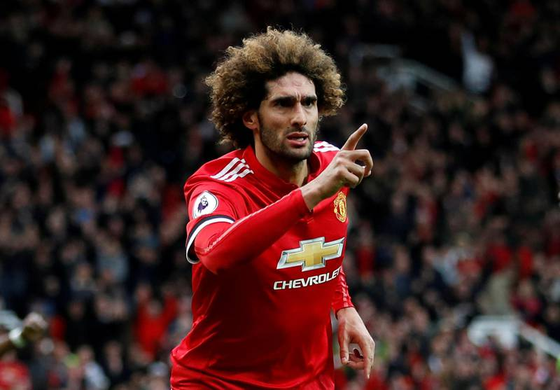 """Soccer Football - Premier League - Manchester United v Arsenal - Old Trafford, Manchester, Britain - April 29, 2018   Manchester United's Marouane Fellaini celebrates scoring their second goal     Action Images via Reuters/Carl Recine    EDITORIAL USE ONLY. No use with unauthorized audio, video, data, fixture lists, club/league logos or """"live"""" services. Online in-match use limited to 75 images, no video emulation. No use in betting, games or single club/league/player publications.  Please contact your account representative for further details.     TPX IMAGES OF THE DAY"""