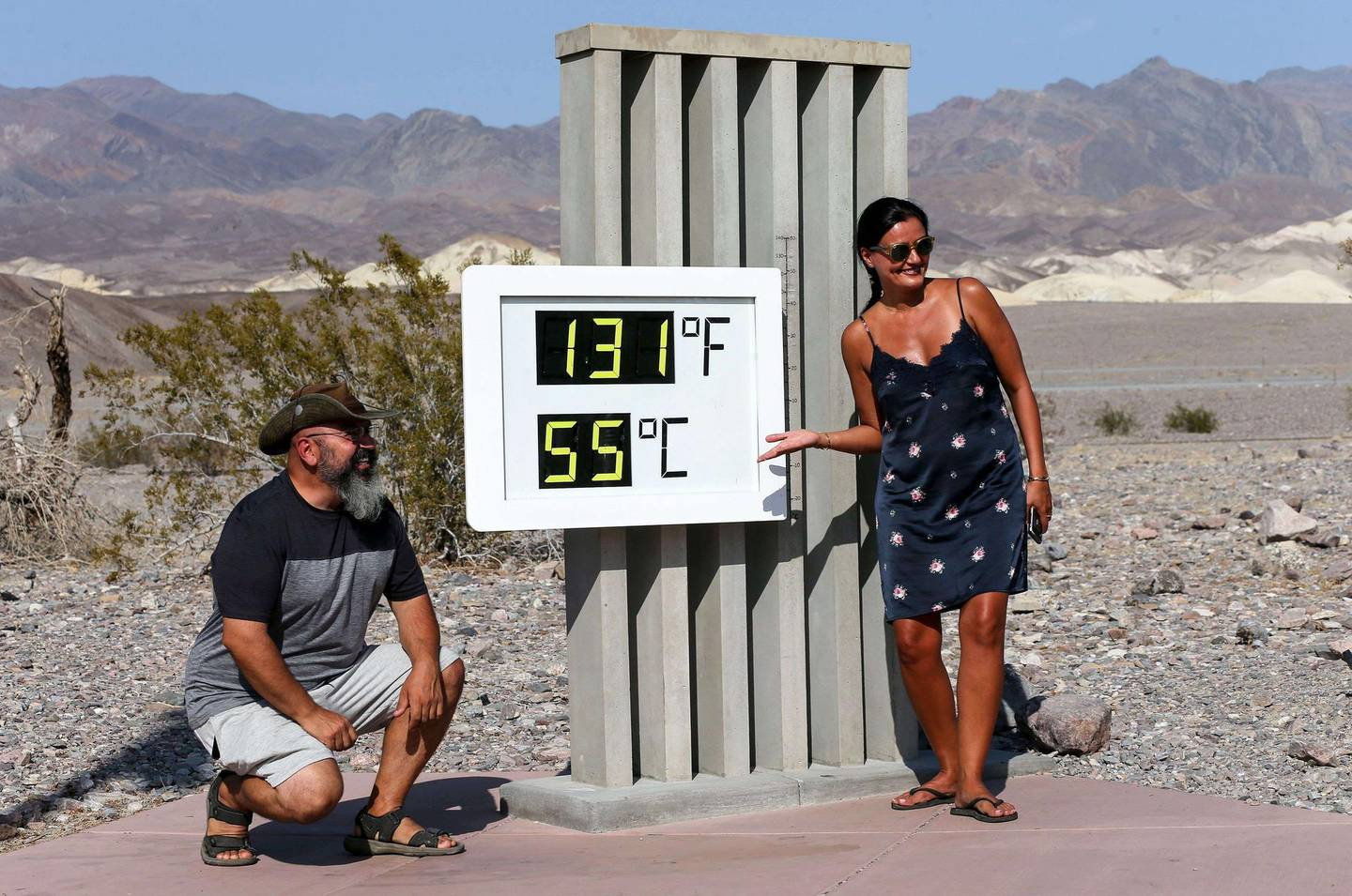 DEATH VALLEY NATIONAL PARK, CALIFORNIA - AUGUST 17: Visitors gather for a photo in front of an unofficial thermometer at Furnace Creek Visitor Center on August 17, 2020 in Death Valley National Park, California. The temperature reached 130 degrees at Death Valley National Park on August 16, hitting what may be the hottest temperature recorded on Earth since at least 1913, according to the National Weather Service. Park visitors have been warned, Travel prepared to survive.   Mario Tama/Getty Images/AFP == FOR NEWSPAPERS, INTERNET, TELCOS & TELEVISION USE ONLY ==
