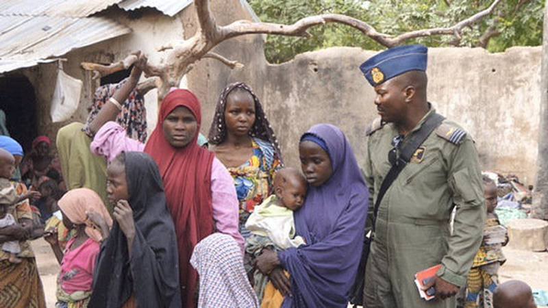 A soldier from the Nigerian Army talks with hostage women and children who were freed from Boko Haram, in Yola, in this April 29, 2015 handout. Nigeria's military rescued another set of women and children who had been kidnapped by Boko Haram militia and were being detained in Sambisa forest where the Islamist group has been holed up, an army spokesman said on April 30. Picture taken April 29, 2015. REUTERS/Nigerian Military/Handout via Reuters     ATTENTION EDITORS - THIS PICTURE WAS PROVIDED BY A THIRD PARTY. REUTERS IS UNABLE TO INDEPENDENTLY VERIFY THE AUTHENTICITY, CONTENT, LOCATION OR DATE OF THIS IMAGE. THIS PICTURE IS DISTRIBUTED EXACTLY AS RECEIVED BY REUTERS, AS A SERVICE TO CLIENTS.  FOR EDITORIAL USE ONLY. NOT FOR SALE FOR MARKETING OR ADVERTISING CAMPAIGNS.