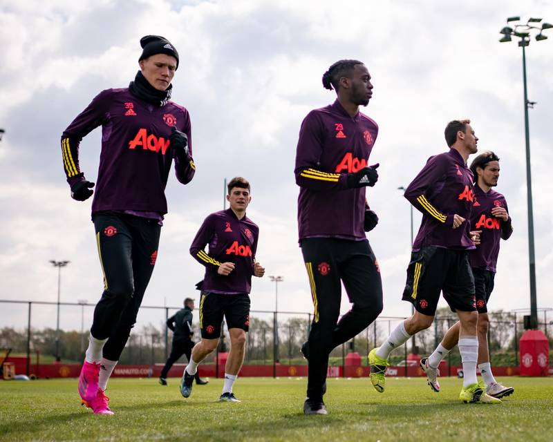 MANCHESTER, ENGLAND - APRIL 14: Scott McTominay, Daniel James, Aaron Wan-Bissaka, Nemanja Matic, Edinson Cavani of Manchester United in action during a first team training session at Aon Training Complex on April 14, 2021 in Manchester, England. (Photo by Ash Donelon/Manchester United via Getty Images)
