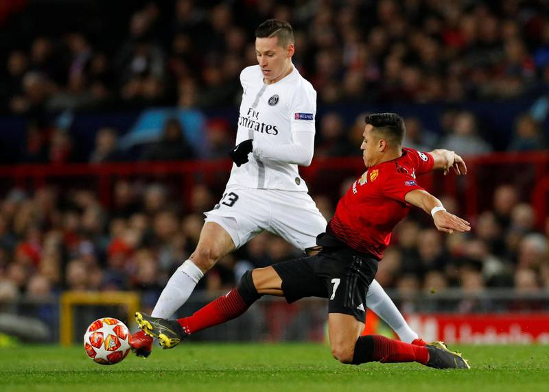 Soccer Football - Champions League Round of 16 First Leg - Manchester United v Paris St Germain - Old Trafford, Manchester, Britain - February 12, 2019  Paris St Germain's Julian Draxler in action with Manchester United's Alexis Sanchez    REUTERS/Phil Noble