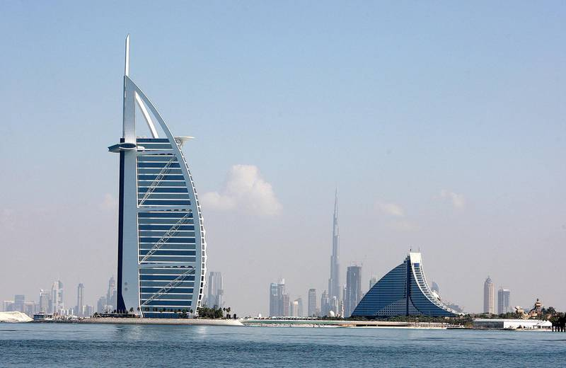DUBAI, UNITED ARAB EMIRATES – Dec 21: View of the Burj Al Arab hotel (left), Jumeirah Beach hotel (right) and Burj Dubai (center) in Dubai. (Pawan Singh / The National) For Stock