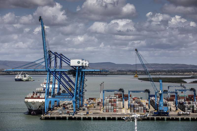 A ship-to-shore crane loads containers onto a ship at Mombasa port, operated by Kenya Ports Authority, in Mombasa, Kenya, on Saturday, Sept. 1, 2018. China's modern-day adaptation of the Silk Road, known as the Belt and Road Initiative, aims to revive and extend trading routes connecting China with Central Asia, the Middle East, Africa and Europe via networks of upgraded or new railways, ports, pipelines, power grids and highways. Photographer: Luis Tato/Bloomberg