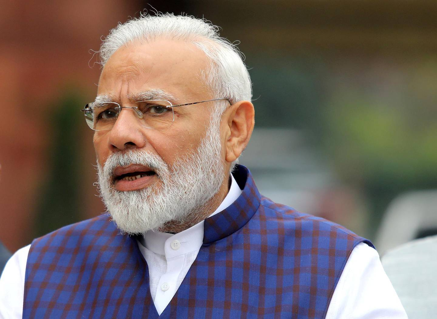 FILE PHOTO: India's Prime Minister Narendra Modi speaks to the media inside the parliament premises on the first day of the winter session in New Delhi, India, November 18, 2019. REUTERS/Altaf Hussain/File Photo