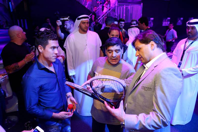 DUBAI, UNITED ARAB EMIRATES - MAY 28:  Diego Maradona speaks to Miguel Angel Rodriguez of Colombia during the men's final match of the PSA Dubai World Series Finals 2016 at Burj Park on May 28, 2016 in Dubai, United Arab Emirates.  (Photo by Francois Nel/Getty Images)