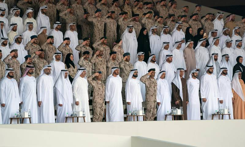 SWEIHAN, ABU DHABI, UNITED ARAB EMIRATES - February 09, 2020: (front row L-R) HH Sheikh Mohamed bin Hamad Al Sharqi, Crown Prince of Fujairah, HH Sheikh Ammar bin Humaid Al Nuaimi, Crown Prince of Ajman, HH Sheikh Sultan bin Mohamed Al Qasimi, Crown Prince of Sharjah, HH Sheikh Hamad bin Mohamed Al Sharqi, UAE Supreme Council Member and Ruler of Fujairah, HH Sheikh Saud bin Rashid Al Mu'alla, UAE Supreme Council Member and Ruler of Umm Al Quwain, HE Major General Essa Saif Al Mazrouei, Deputy Chief of Staff of the UAE Armed Forces, HH Sheikh Mohamed bin Zayed Al Nahyan, Crown Prince of Abu Dhabi and Deputy Supreme Commander of the UAE Armed Forces, HH Sheikh Mohamed bin Rashid Al Maktoum, Vice-President, Prime Minister of the UAE, Ruler of Dubai and Minister of Defence, HE Lt General Hamad Thani Al Romaithi, Chief of Staff UAE Armed Forces, HH Sheikh Humaid bin Rashid Al Nuaimi, UAE Supreme Council Member and Ruler of Ajman, HH Sheikh Saud bin Saqr Al Qasimi, UAE Supreme Council Member and Ruler of Ras Al Khaimah, HH Sheikh Hamdan bin Mohamed Al Maktoum, Crown Prince of Dubai, HH Sheikh Rashid bin Saud bin Rashid Al Mu'alla, Crown Prince of Umm Al Quwain, HE Mohamed Ahmad Al Bowardi, UAE Minister of State for Defence Affairs and HH Sheikh Hamdan bin Rashid Al Maktoum, Deputy Ruler of Dubai and UAE Minister of Finance, stand for the national anthem during a reception to celebrate and honor members of the UAE Armed Forces who participated in the Arab coalition in Yemen, at Zayed Military City.  ( Eissa Al Hammadi for the Ministry of Presidential Affairs ) ---