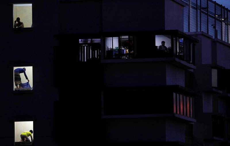 Migrant workers pray in their dormitory during the holy month of Ramadan, amid the coronavirus disease (COVID-19) outbreak, in Singapore May 8, 2020. Picture taken May 8, 2020. REUTERS/Edgar Su
