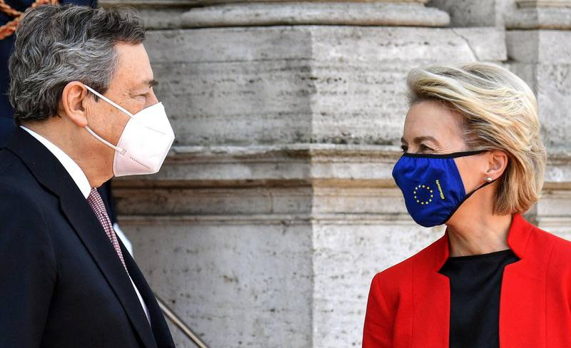 Italian Prime Minister Mario Draghi (L) and European Commission President Ursula von der Leyen talk upon arrival for the Global Health Summit at the Villa Doria Pamphili in Rome on May 21, 2021, to discuss on how to recover from the Covid-19 pandemic and how to prevent it happening again. The EU is expected to announce a new initiative to support local manufacturing in Africa as the leaders emphasise the importance of scaling up vaccination efforts, including through the Covax vaccine-sharing programme. / AFP / Tiziana FABI