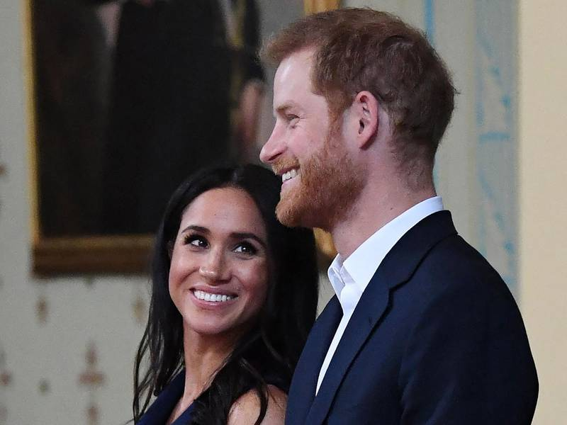(FILES) In this file photo taken on October 18, 2018 Britain's Prince Harry and Meghan, Duchess of Sussex attend a reception at Government House in Melbourne. Prince Harry and his wife Meghan announced the birth of their daughter Lilibet Diana US media reported on May 6, 2021. / AFP / POOL / JULIAN SMITH