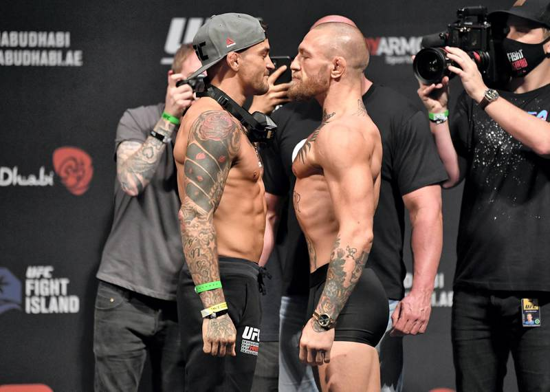 ABU DHABI, UNITED ARAB EMIRATES - JANUARY 22: (L-R) Opponents Dustin Poirier and Conor McGregor of Ireland face off during the UFC 257 weigh-in at Etihad Arena on UFC Fight Island on January 22, 2021 in Abu Dhabi, United Arab Emirates. (Photo by Jeff Bottari/Zuffa LLC) *** Local Caption *** ABU DHABI, UNITED ARAB EMIRATES - JANUARY 22: (L-R) Opponents Dustin Poirier and Conor McGregor of Ireland face off during the UFC 257 weigh-in at Etihad Arena on UFC Fight Island on January 22, 2021 in Abu Dhabi, United Arab Emirates. (Photo by Jeff Bottari/Zuffa LLC)