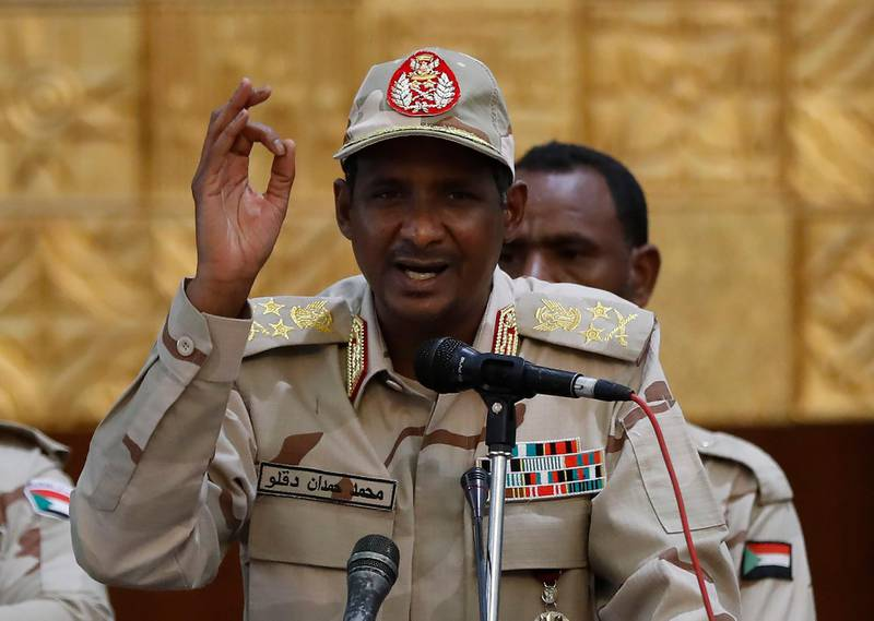 Sudanese Gen. Mohammed Hamdan Dagalo, the deputy head of the military council, addresses a speech to his supporters, during a rally to support the new military council that assumed power in Sudan after the overthrow of President Omar al-Bashir, and o protect the people's revolution, in Khartoum, Sudan, Sunday, June 16, 2019. Sudanese officials say al-Bashir is being taken to the prosecutor's office for corruption probe. (AP Photo/Hussein Malla)