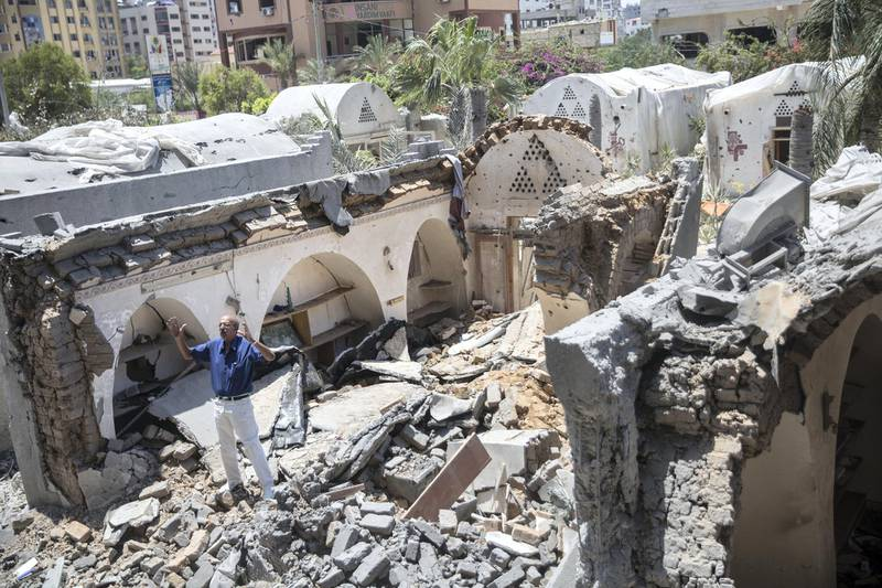 Palestinian merchant Joma Al Zaeem stands in the rubble of his copper shop , one of the many craft shops that Israeli missiles  damaged at  the ÒArts and Crafts Village , a museum managed by the City Council in Gaza. It was   founded by late Palestinian President Yasser Arafat in 1998, with financial support from the United Nations Development Program. Last Saturday Israeli planes carried out attacks on dozens of targets in the Gaza Strip in the most extensive Israeli military assault since the 2014 ÒOperation Protective EdgeÓ in which over 2,200 Palestinians were killed. (Photo by Heidi Levine for The National).