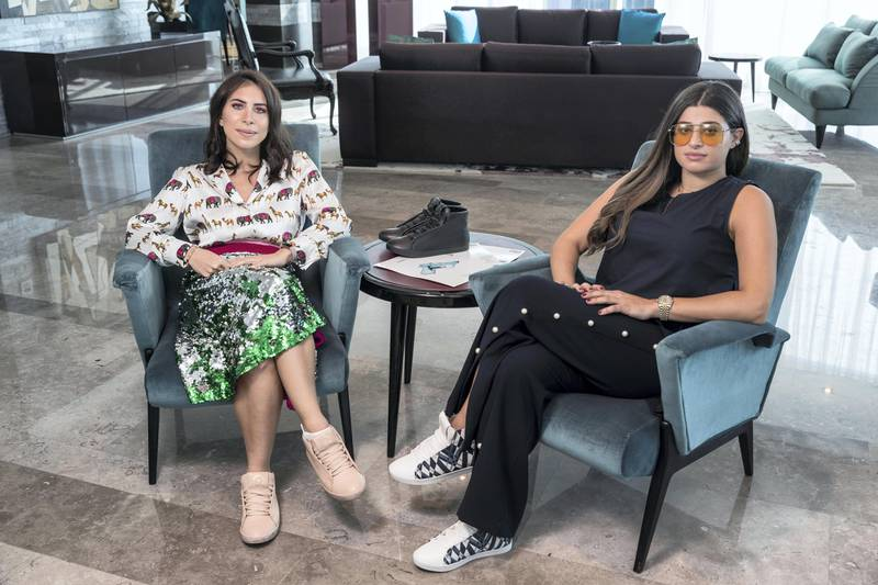 DUBAI, UNITED ARAB EMIRATES. 03 October 2017. STANDALONE. Nour Al Tamimi (White shirt) and Basma Chidiac (Blue) founders of the Nou Project with some of their art sneakers. (Photo: Antonie Robertson/The National) Journalist: Hafsa Lodi. Section: National.