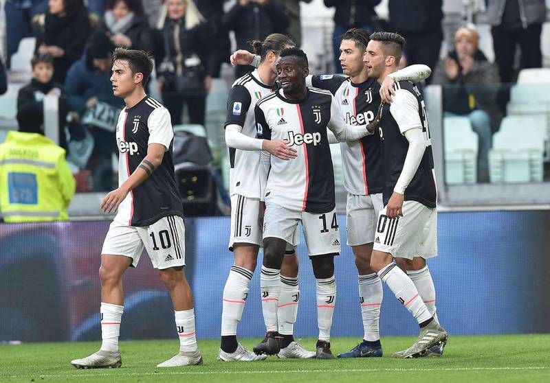epa08329336 (FILE) - Juventus' Cristiano Ronaldo (2R) celebrates with his teammates after scoring the 2-0 goal during the Italian Serie A soccer match Juventus FC vs Udinese Calcio at the Allianz Stadium in Turin, Italy, 15 December 2019 (reissued on 28 March 2020). On 28 March 2020 Juventus FC announced, amid the COVID-19  coronavirus crisis, to have 'reached an understanding with players and coach of the First Team for the reduction of their compensation for an amount equal to the monthly payments of March, April, May and June 2020'.  EPA/ALESSANDRO DI MARCO