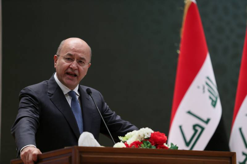 REFILE - CORRECTING GRAMMAR Barham Salih, Iraq's newly elected president, delivers a speech at the parliament headquarters, in Baghdad, October 2, 2018. Iraqi Parliament Office/Handout via REUTERS ATTENTION EDITORS - THIS PICTURE WAS PROVIDED BY A THIRD PARTY. NO RESALES. NO ARCHIVE.