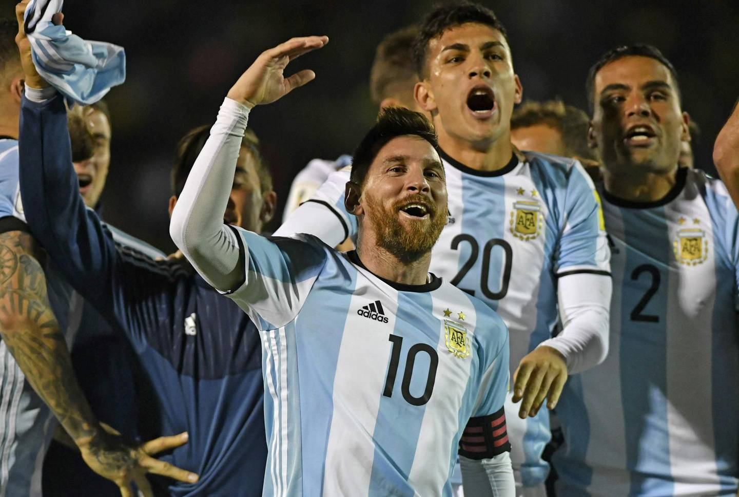 (FILES) This file photo taken on October 10, 2017 shows Argentina's Lionel Messi (C) celebrating after defeating Ecuador and qualifying to the 2018 World Cup football tournament, in Quito, Ecuador. The World Cup 2018 group stage draw for the June 14-July 15 tournament is to take place on December 1, 2017 in Moscow. / AFP PHOTO / Juan Ruiz