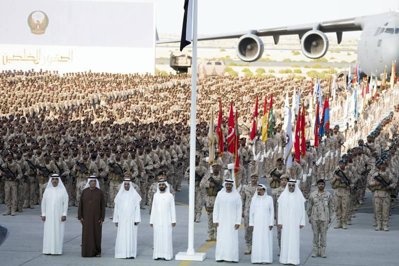 SWEIHAN, ABU DHABI, UNITED ARAB EMIRATES - February 09, 2020: (L-R) HH Sheikh Saud bin Rashid Al Mu'alla, UAE Supreme Council Member and Ruler of Umm Al Quwain, HH Sheikh Saud bin Saqr Al Qasimi, UAE Supreme Council Member and Ruler of Ras Al Khaimah, HH Sheikh Hamad bin Mohamed Al Sharqi, UAE Supreme Council Member and Ruler of Fujairah, HH Sheikh Mohamed bin Rashid Al Maktoum, Vice-President, Prime Minister of the UAE, Ruler of Dubai and Minister of Defence, HH General Sheikh Mohamed bin Zayed Al Nahyan Crown Prince of Abu Dhabi Deputy Supreme Commander of the UAE Armed Forces, HH Sheikh Humaid bin Rashid Al Nuaimi, UAE Supreme Council Member and Ruler of Ajman and HH Sheikh Sultan bin Mohamed Al Qasimi, Crown Prince of Sharjah stand for a photograph during a reception to celebrate and honor members of the UAE Armed Forces who participated in the Arab coalition in Yemen, at Zayed Military City.   ( Hamad Al Kaabi / Ministry of Presidential Affairs ) ---