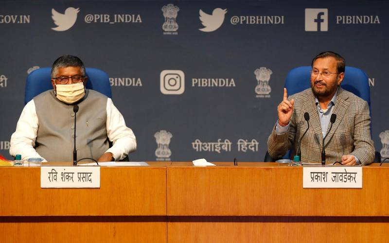 FILE - In this Thursday, Feb. 25, 2021, file photo, India's Information Technology Minister Ravi Shankar Prasad, left, and Information and Broadcasting Minister Prakash Javadekar address a press conference announcing new regulations for social media companies and digital streaming websites in New Delhi, India. India's government on Saturday, June 5, warned Twitter to immediately comply with the country's new social media regulations, which critics say give the government more power to police online content. (AP Photo/Manish Swarup, File)