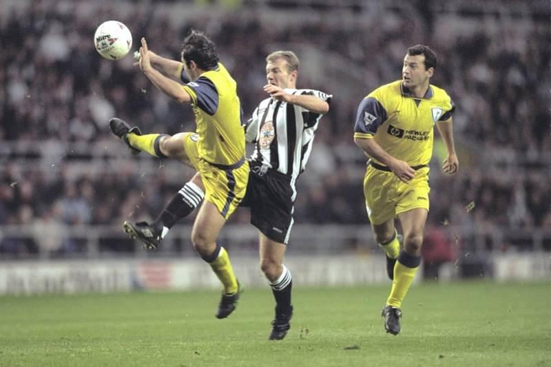 28 Dec 1996:  Alan Shearer of Newcastle beats Stephen Carr of Tottenham to score during their Premier League match at St. James Park, Newcastle. Newcastle won 7-1. Mandatory Credit: Mark Thompson/Allsport