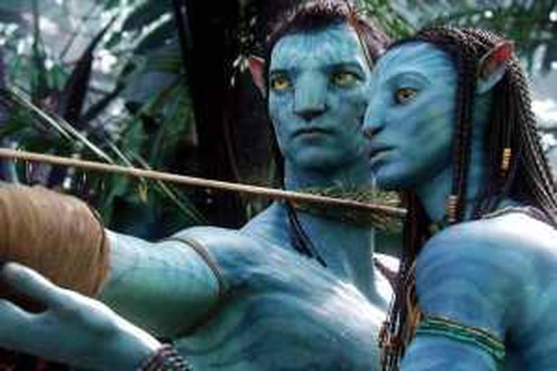 """FILE - In this file film publicity image released by 20th Century Fox, the character Neytiri, voiced by Zoe Saldana, right, and the character Jake, voiced by Sam Worthington are shown in a scene from, """"Avatar."""" Cameron's """"Avatar"""" has shot past """"Star Wars"""" to become the No. 3 movie on the all-time domestic box office charts. Next stop: """"The Dark Knight."""" Cameron's science-fiction saga took in US$41.3 million over the weekend, raising its domestic total to US$491.8 million. Worldwide, """"Avatar"""" has grossed US$1.5 billion. (AP Photo/20th Century Fox, File) *** Local Caption ***  NY131_Box_Office.jpg *** Local Caption ***  NY131_Box_Office.jpg"""