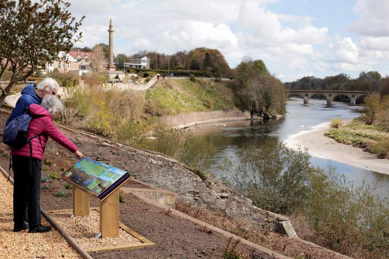 Tourists at a River Tweed and Coldstream Bridge viewing point. The river acts as the border between Scotland and England. Photograph: Stuart Boulton