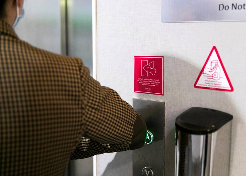 DUBAI, UNITED ARAB EMIRATES. 11 OCTOBER 2020. Residents are required to use their elbows for the elevator buttons at Ramada Hotel and Suites by Wyndham Dubai JBR.(Photo: Reem Mohammed/The National)Reporter:Section: