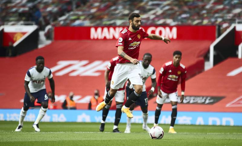 MANCHESTER, ENGLAND - OCTOBER 04: Bruno Fernandes of Manchester United scores his sides first goal during the Premier League match between Manchester United and Tottenham Hotspur at Old Trafford on October 04, 2020 in Manchester, England. Sporting stadiums around the UK remain under strict restrictions due to the Coronavirus Pandemic as Government social distancing laws prohibit fans inside venues resulting in games being played behind closed doors. (Photo by Carl Recine - Pool/Getty Images)