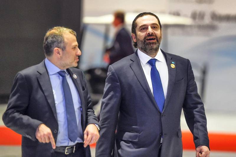 Lebanese Prime Minister Saad Hariri (R) along with Foreign Minister Gebran Bassil arrive to the International Congress Centre on February 24, 2019, ahead of first joint European Union and Arab League summit in the Egyptian Red Sea resort of Sharm el-Sheikh. (Photo by MOHAMED EL-SHAHED / AFP)