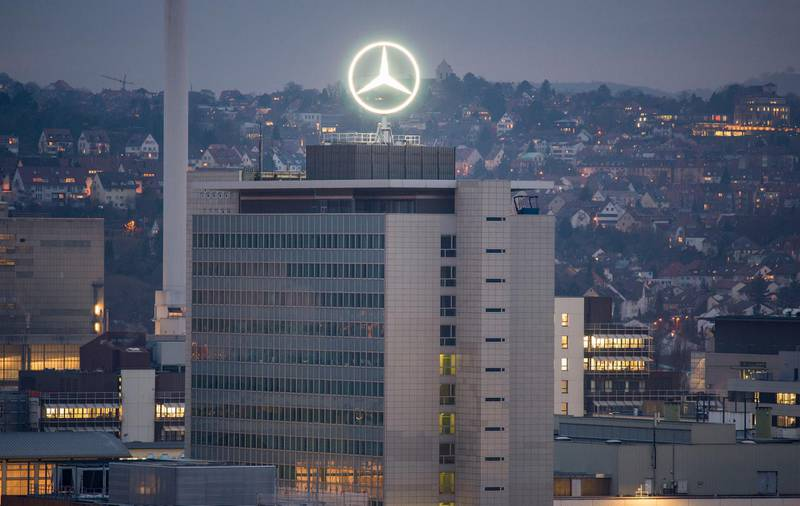 The Mercedes star is illuminated on the headquarters of Daimler AG in Stuttgart, southwestern Germany, on February 1, 2017, the day before German luxury carmaker Daimler AG's annual results press conference. (Photo by THOMAS KIENZLE / AFP)